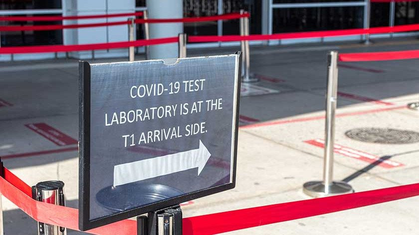 Sign for COVID PCR testing.